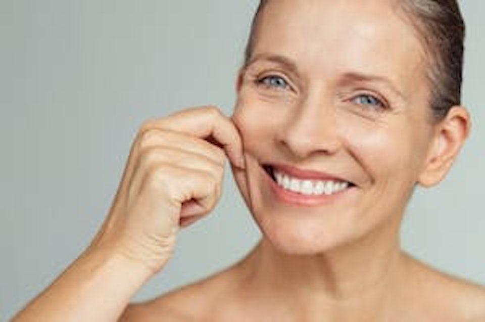 Kollagen i huden på kvinne